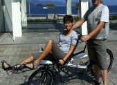 Natt and Paul on 'white giraffe' tandem bicycle